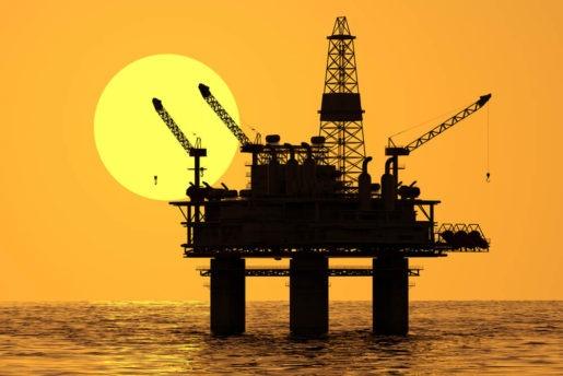 Image of oil platform during sunset.