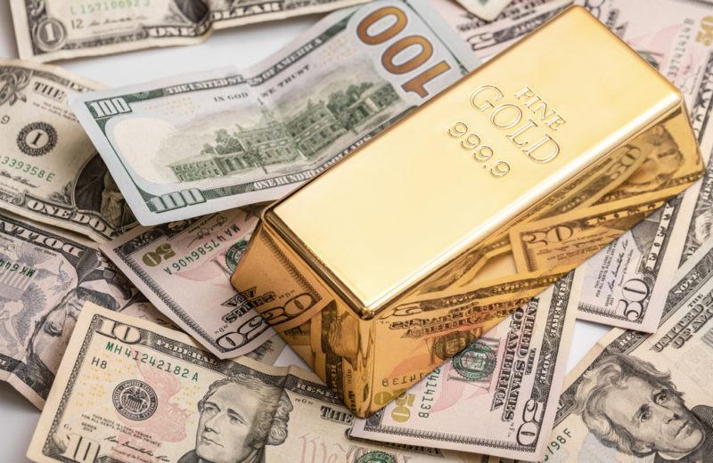 Battle of the Safe Havens: Gold Down, Dollar Up
